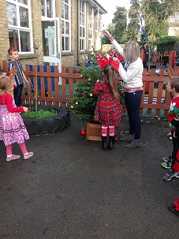 Pupils from Robins kindly presented a tree to Mrs Foston